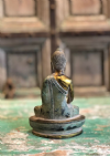 Bronze casting of the buddha, golden detailing in bhumispasha hand mudra (enlightenment)